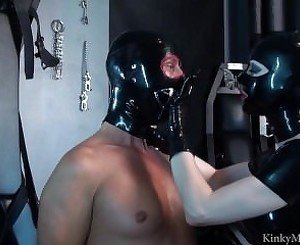 Kinky Mistress in latex fucks helpless slave with strapon