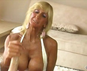 Blond Mature handjob and titfuck