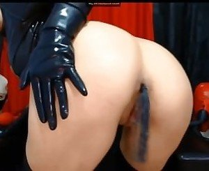 Anal play in latex dress on latexcamera .com