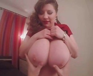 Big titted Super MIlf teases you with her Huge Juggs and Massive Ass