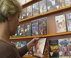 Horny Mom Satisfies her Needs At The Video Store