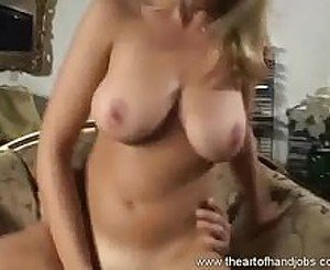 Babe with sexy shaved pussy does an erotic hand job