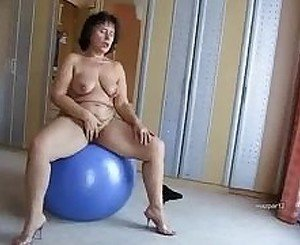 Chubby mature loves to play with the ball