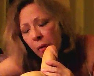 Horny mature wife sucks a squirting dildo