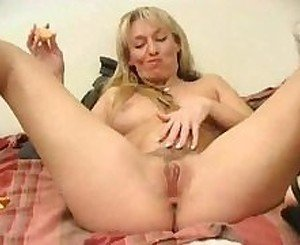 Blonde plays with an orange