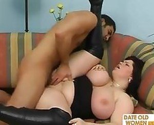 Mature BBW with black boots fucking on the sofa