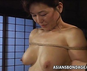 Mature bitch gets roped up and hung in a bdsm