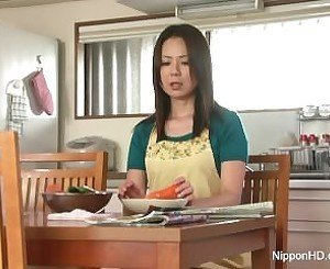 Asian MILF masturbates with a carrot
