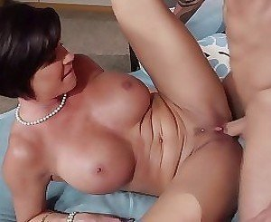 Black-haired mommy gives a truly sweet titjob