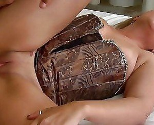 Corset-wearing blonde pounded on a couch