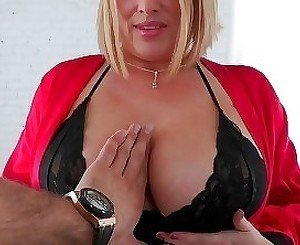 Glamorous blonde with giant tits is giving a sweet titjob