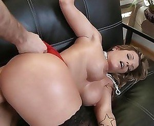 Red and black blonde MILF enjoys fucking on a leather couch